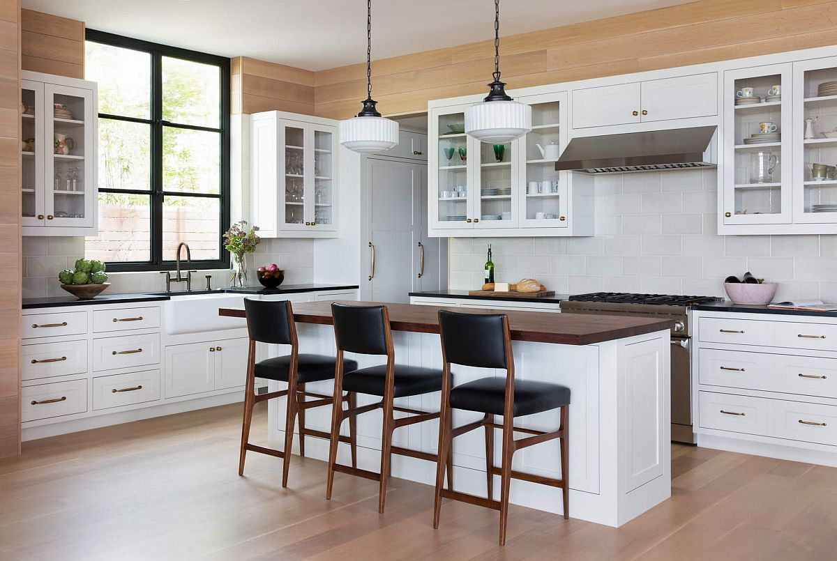 Large modern kitchen in white and wood feels just inviting!