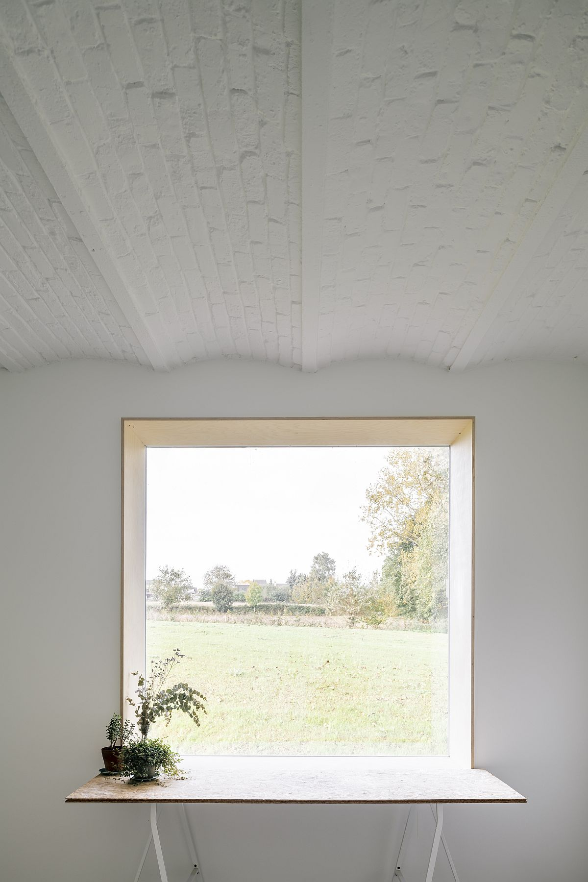 Large-windows-and-opening-bring-natural-light-into-the-renovated-Belgian-home-67853