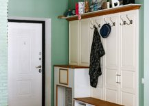 Light-and-pastel-green-combined-with-white-and-wood-in-the-smart-entryway-48036-217x155