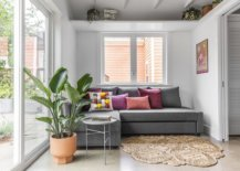 Living-area-with-a-comfy-gray-sectional-and-sliding-doors-welcomes-guests-79898-217x155