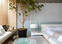 Lovely-bedside-table-coupled-with-large-indoor-plant-and-custom-seating-in-the-corner-add-to-the-relaxing-bedroom-environment-17508-217x155