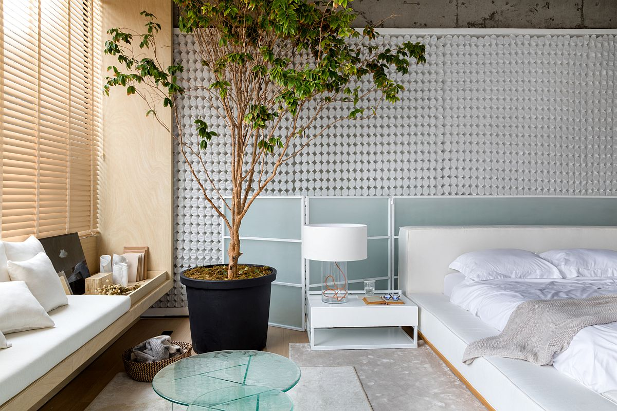 Lovely-bedside-table-coupled-with-large-indoor-plant-and-custom-seating-in-the-corner-add-to-the-relaxing-bedroom-environment-17508