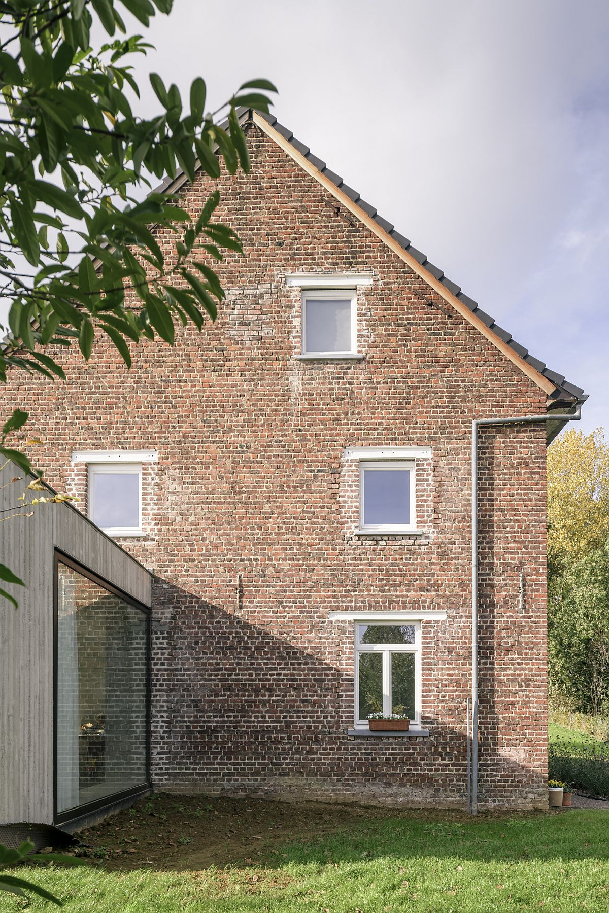 Lovely brick walls of the house are preserved to enhance it timeless appeal
