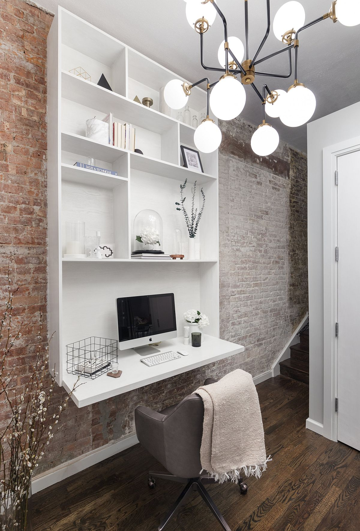 Lovely-chandelier-and-brick-walls-give-unique-appeal-to-this-small-home-workspace-in-the-hallway-93141