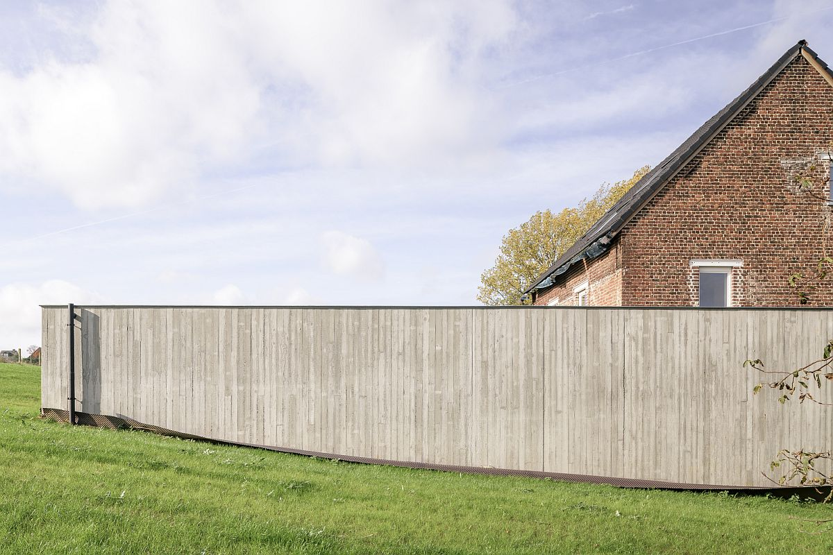 Lovely wood wall offers privacy for those inside the new extension