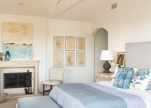 Luxurious-master-bedroom-of-Malibu-beach-house-in-white-and-blue-with-an-elegant-gallery-wall-92324-217x155