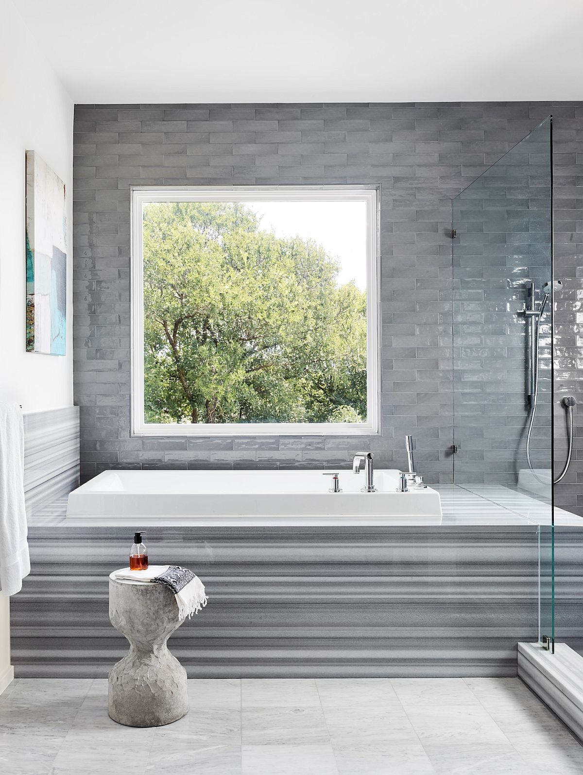 Master bathroom in white with gray tiles that create a lovely background and bathtub