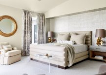 Master-bedroom-in-white-where-the-bedside-table-lamps-bring-symmetry-to-the-large-space-78928-217x155