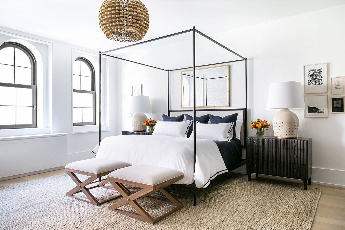 Minimal bedroom with a slim four-poster bed that steals the show with lovely use of straight lines