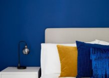 Modern and minimal bedside table lamp in a bedroom filled with plenty of blue 26536 217x155 - Black, White and Brilliant Pops of Yellow Revitalize Old Epsom Apartment