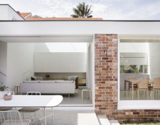 Mesmerizing Minimalism Anchored in White: New Extension to Aging Suburban Home