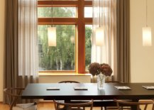 Modern-formal-dining-area-in-beige-with-lovely-drapes-and-trio-of-pendant-lights-41073-217x155
