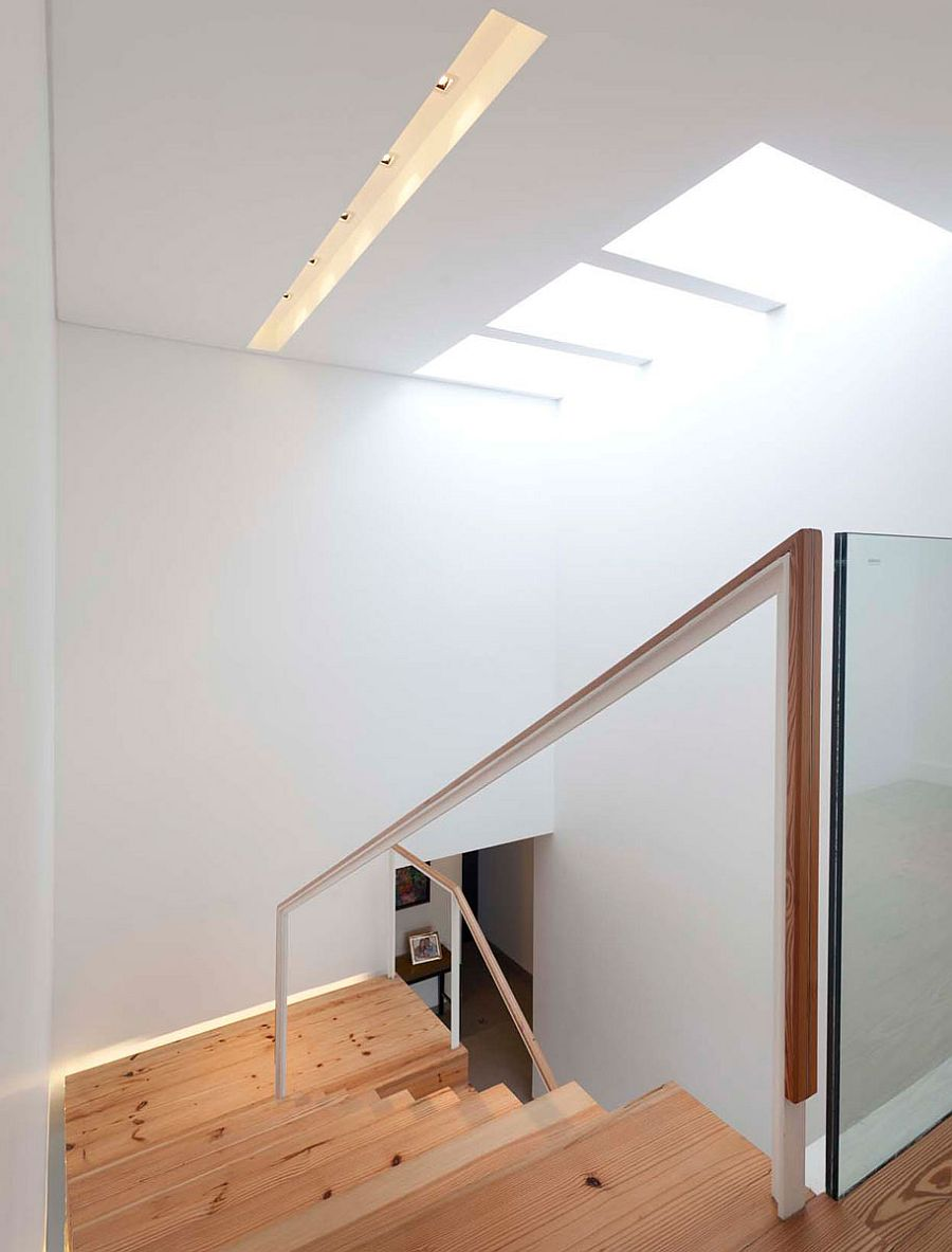 Natural-light-makes-its-way-into-the-stairwell-thanks-to-a-skylight-56456