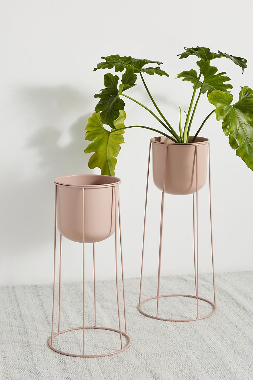 Pink metal plant stand for indoors or outdoors