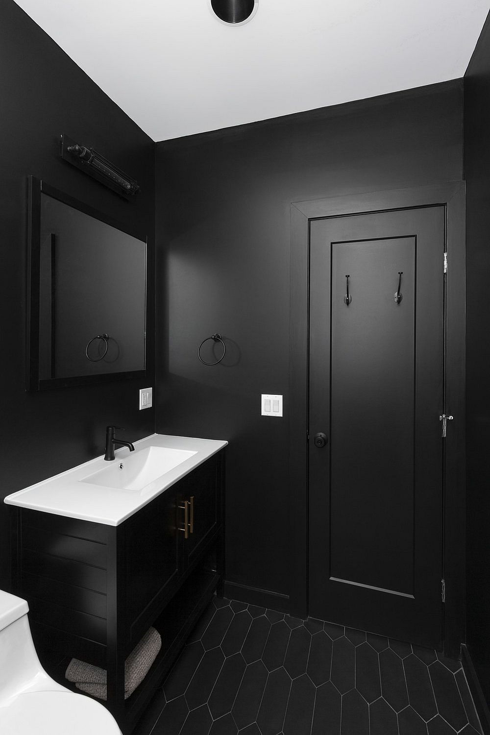 Polished-contemporary-bathroom-in-black-with-black-tiled-floor-and-white-ceiling-15118