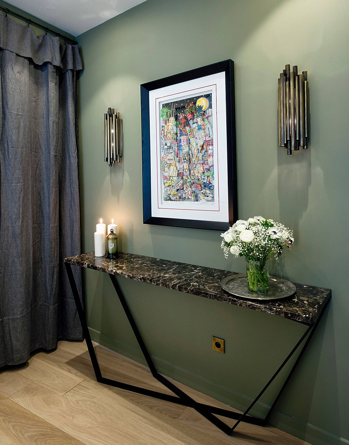 Polished contemporary entry of Paris apartment in deep green with a slim console table and sconce lighting