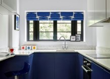 Polished contemporary kitchen in white and blue with blue cabinets below and white cabinets above 53619 217x155 - Black, White and Brilliant Pops of Yellow Revitalize Old Epsom Apartment