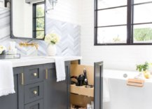 Polished-industrial-farmhouse-bathroom-in-white-with-gray-cabinets-and-ample-natural-light-49131-217x155