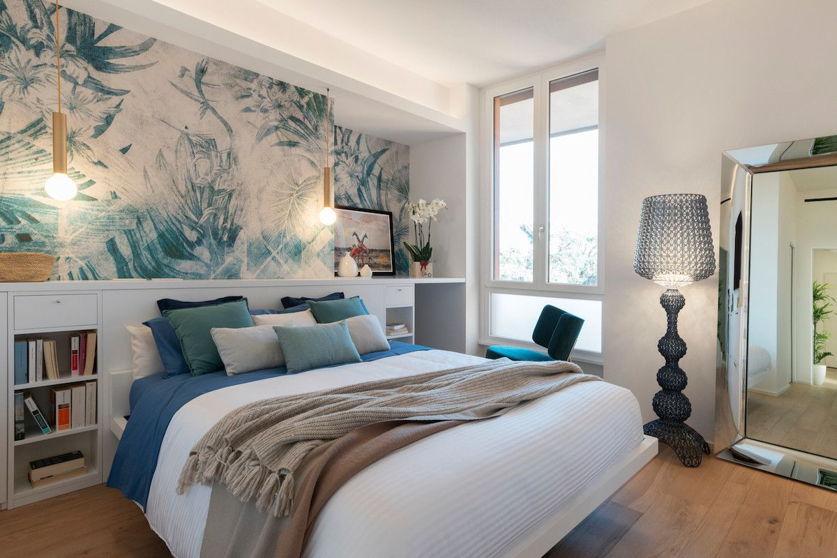 Relaxing beach style coupled with pops of blue and green in the bedroom