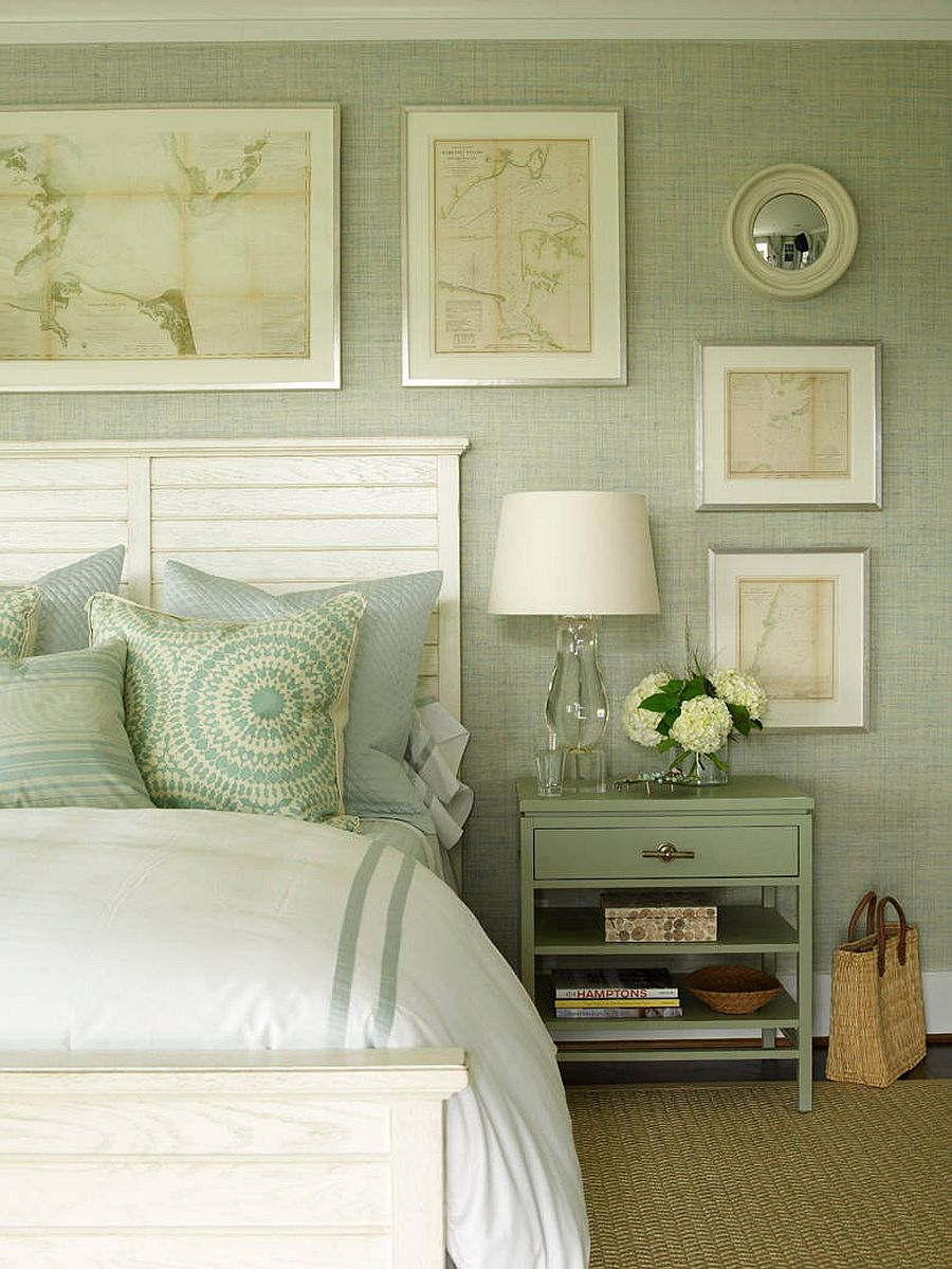 Relaxing bedroom in pastel green and white with a gallery wall that adds to its charming appeal