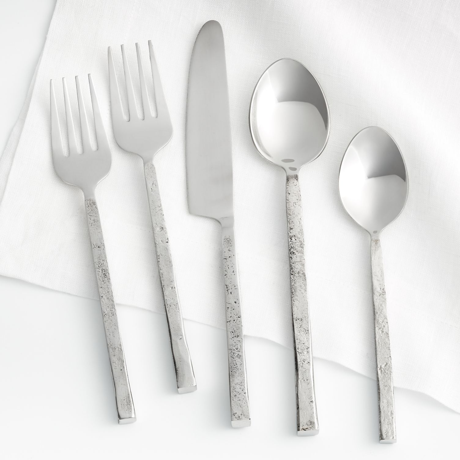 Rustic flatware with hand-forged handles