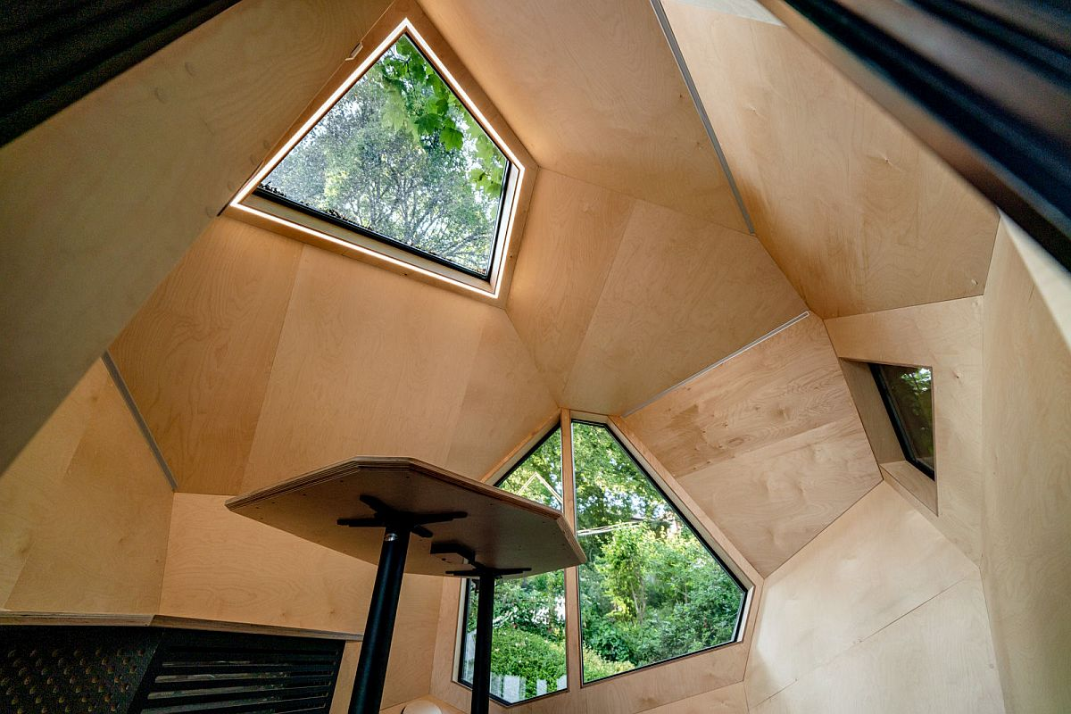Skylight-brings-ample-natural-light-into-the-small-and-woodsy-cabin-with-special-geo-deisgn-94996