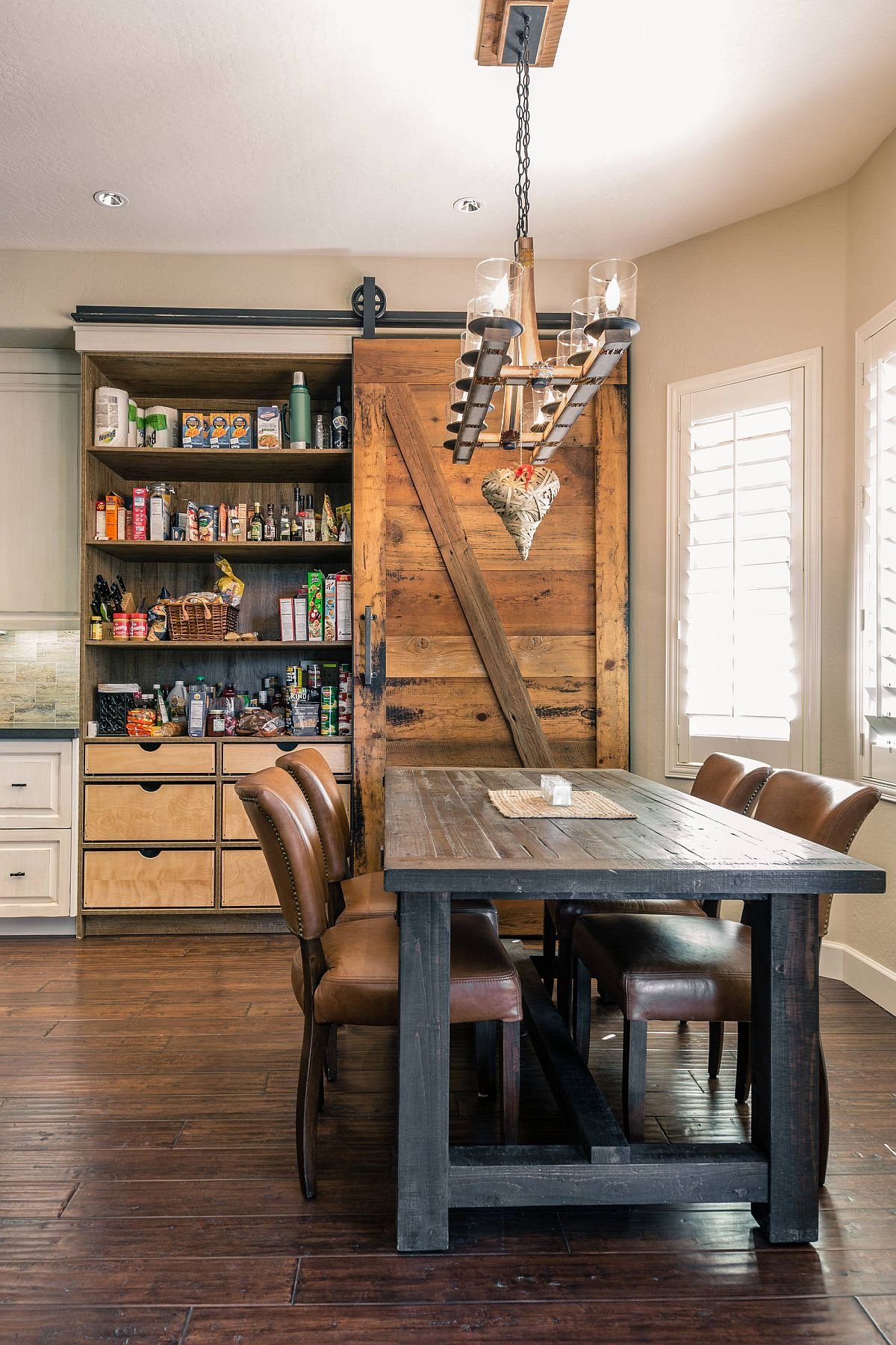 Sliding barn style door is just perfect for the industrial-farmhouse style kitchen