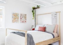 Small-bedroom-in-white-with-pops-of-bright-pink-and-red-along-with-an-open-vaulted-ceiling-90480-217x155