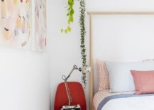 Small-red-chair-used-as-bedside-table-in-the-modest-vacation-home-bedroom-65975-217x155
