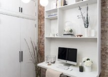 Small-space-savvy-home-office-with-brick-walls-and-custom-white-wall-unit-that-also-acts-as-work-desk-98224-217x155
