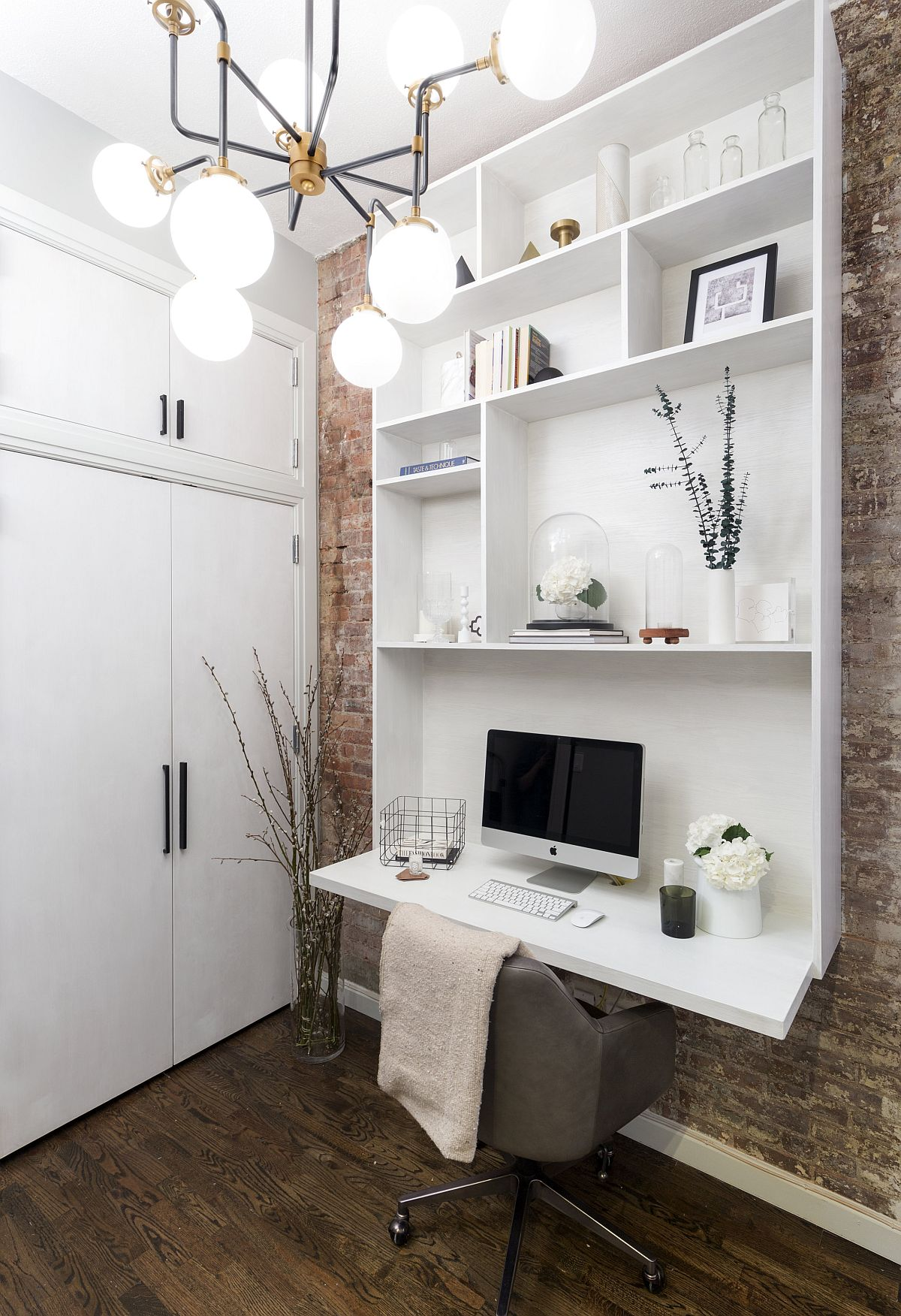 Small-space-savvy-home-office-with-brick-walls-and-custom-white-wall-unit-that-also-acts-as-work-desk-98224