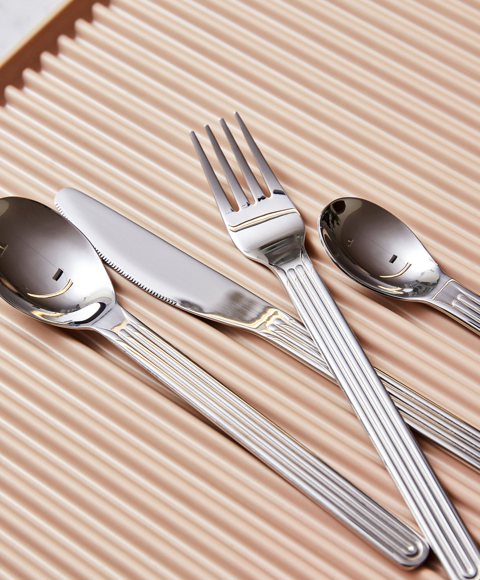 Stainless steel grooved flatware from Hay
