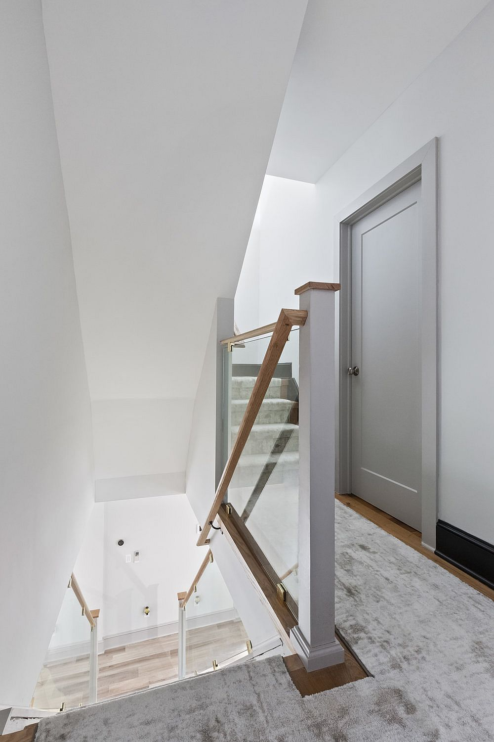 Staircase-inside-the-renovated-NY-townhouse-with-natural-light-illuminating-the-space-10207