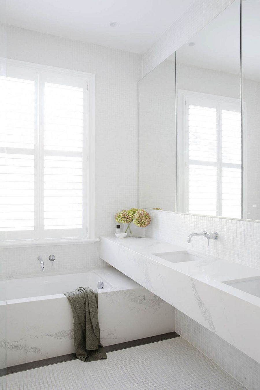 Stone-and-tile-create-a-cool-monochromatic-bathroom-in-white-full-of-light-64921