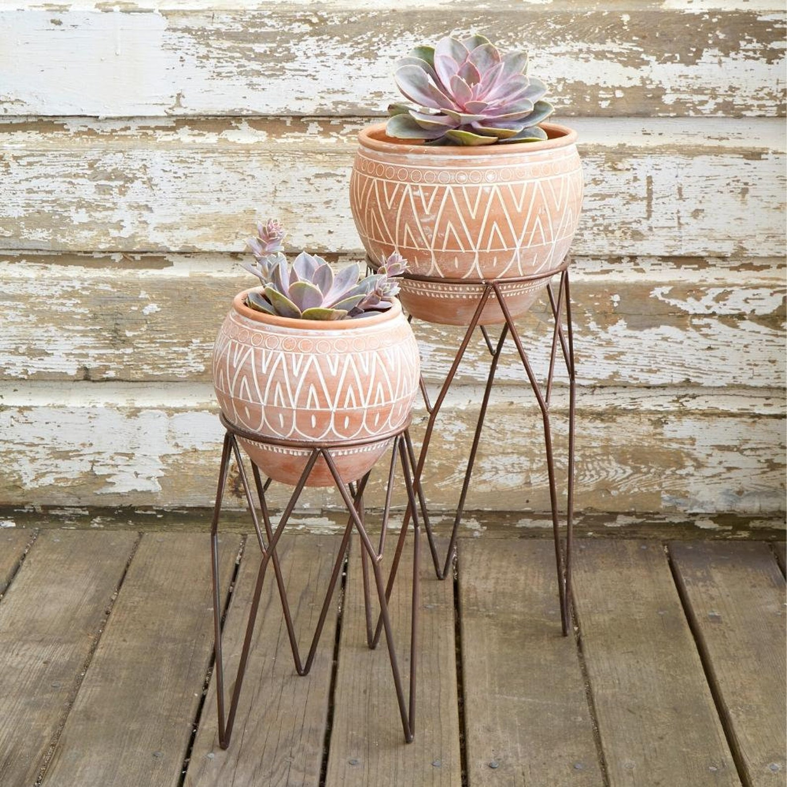 Terracotta pots with metal stands