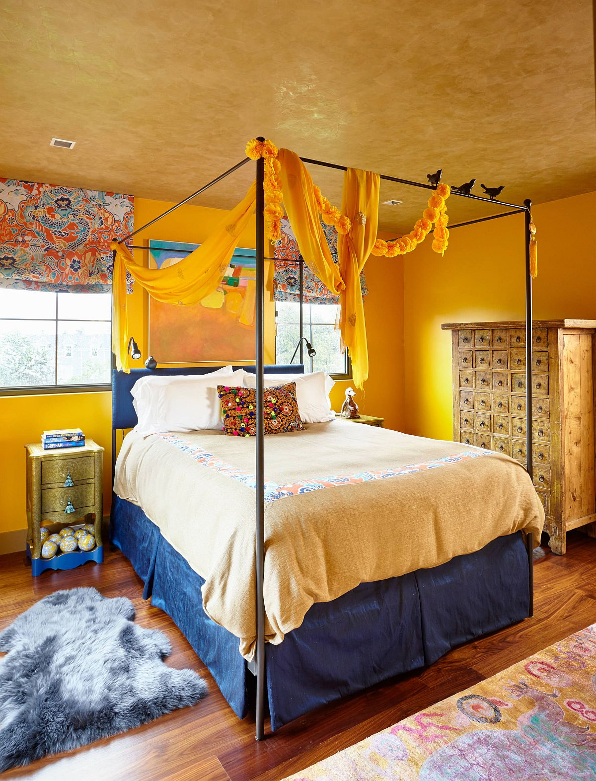 Textured-yellow-ceiling-steals-the-show-in-this-eclectic-edroom-with-a-bit-of-blue-as-well-79771