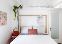 Tiny-bedroom-in-white-with-red-accents-and-a-bit-of-greenery-34931-217x155
