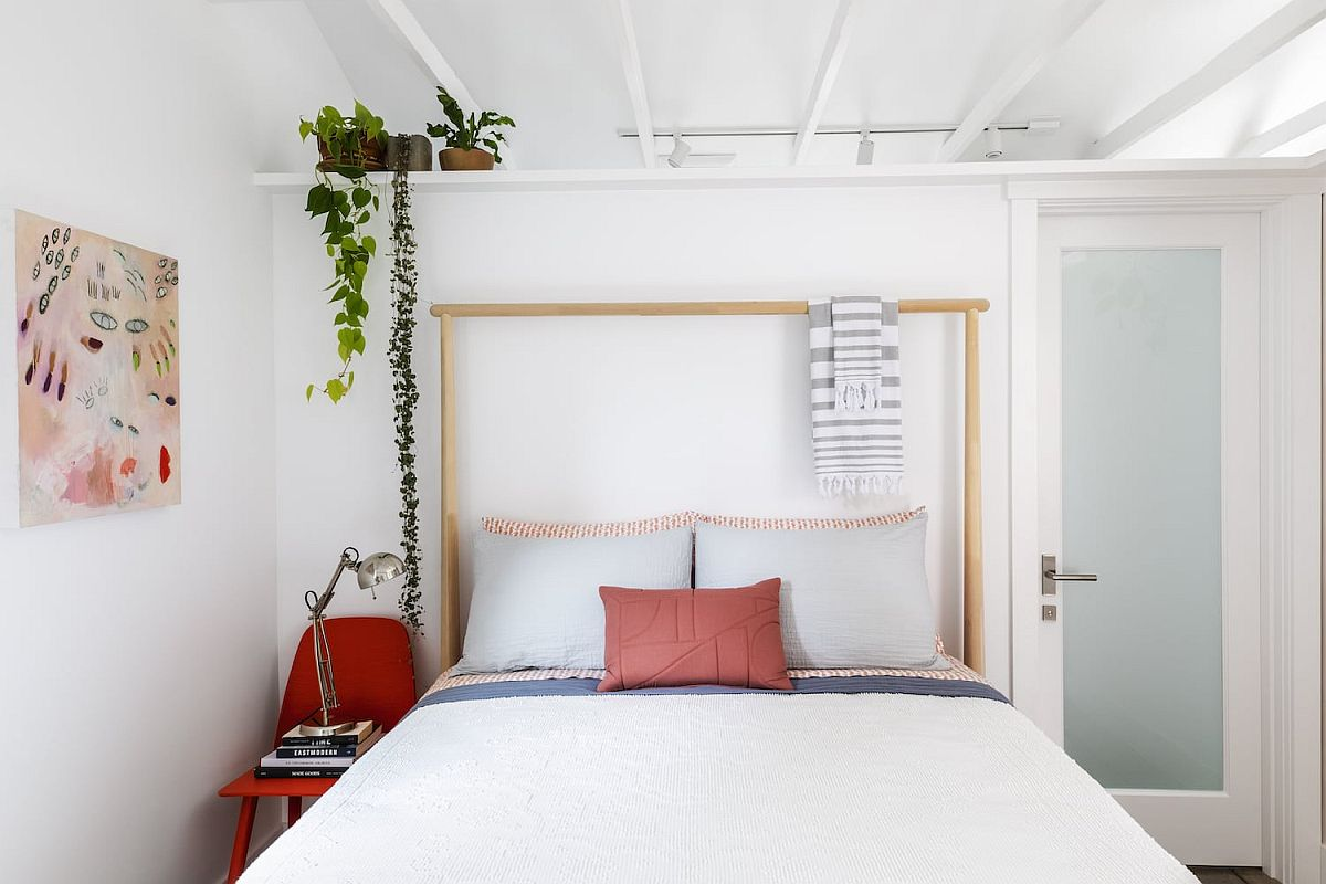 Tiny bedroom in white with red accents and a bit of greenery