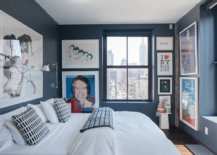 Tiny-bedroom-of-Manhattan-apartment-with-dark-gray-walls-that-act-like-a-lovely-gallery-display-21349-217x155