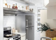 Tiny-kitchen-of-New-York-loft-with-stainless-steel-appliances-and-white-tiled-walls-87970-217x155