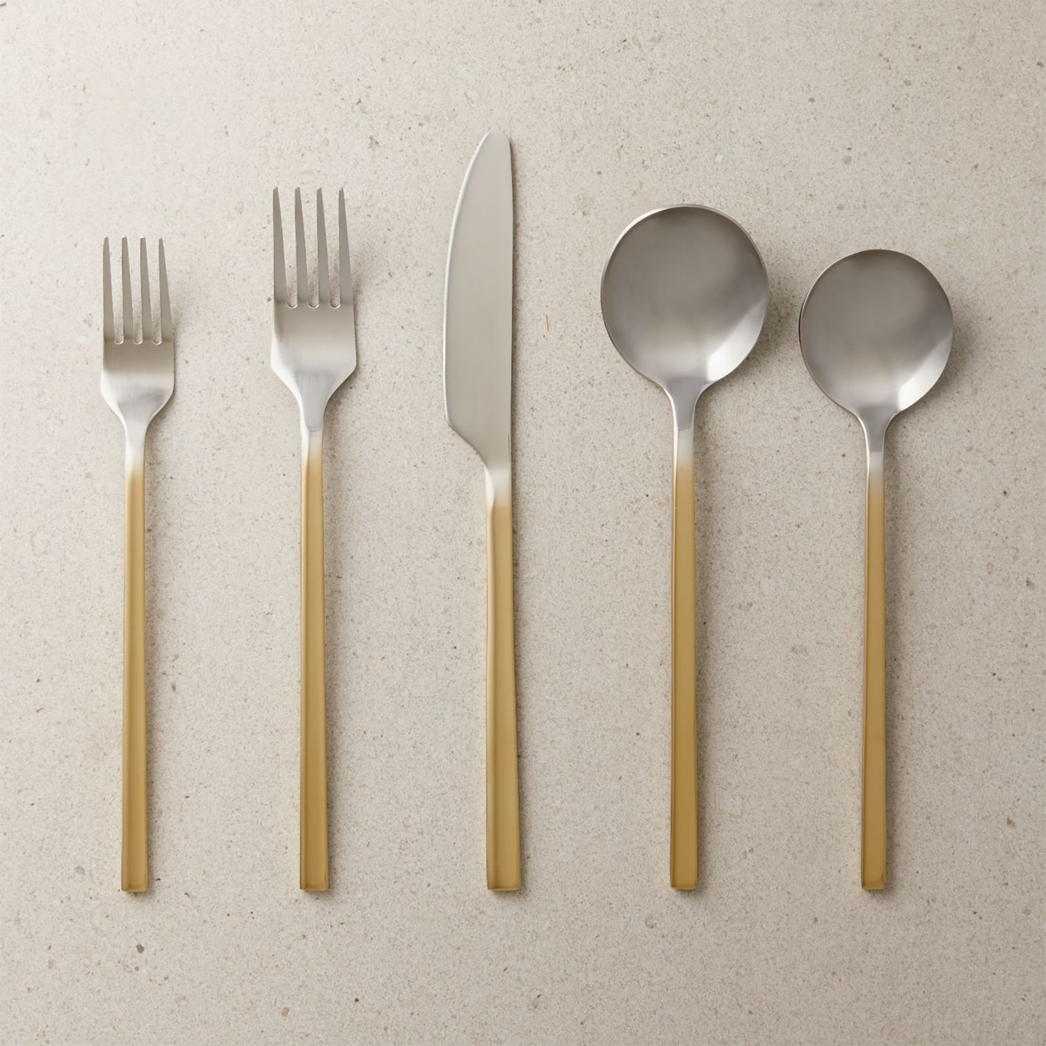 Two-toned flatware with a fade effect