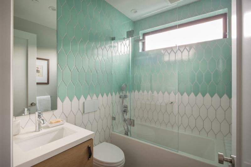 Two-toned shower backsplash from Fireclay Tile