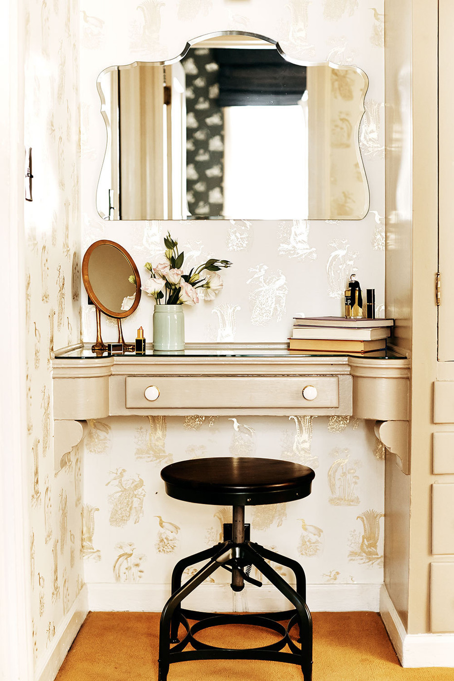 Vanity area with gilded wallpaper
