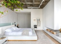 Walls-made-from-backlit-panel-consisting-of-encased-coils-and-exposed-concrete-roof-give-the-bedroom-setting-a-unique-appeal-54004-217x155