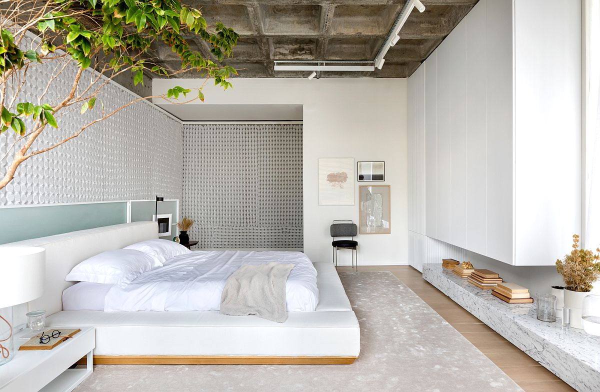Walls-made-from-backlit-panel-consisting-of-encased-coils-and-exposed-concrete-roof-give-the-bedroom-setting-a-unique-appeal-54004