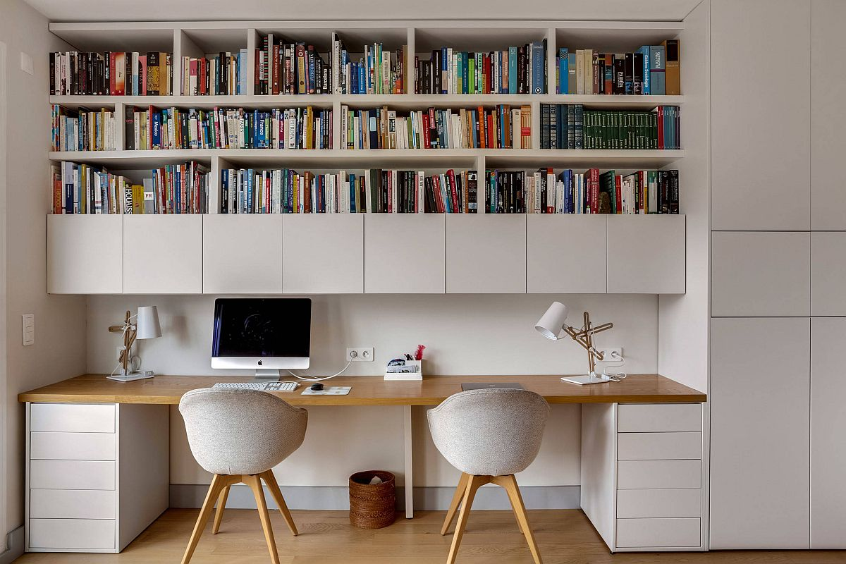 White-home-office-of-Paris-home-with-space-for-two-and-a-lovely-bookshelf-above-88735