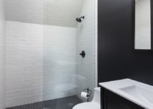 White-shower-area-with-a-skylight-gives-the-bathroom-a-brighter-more-spacious-appeal-35087-217x155
