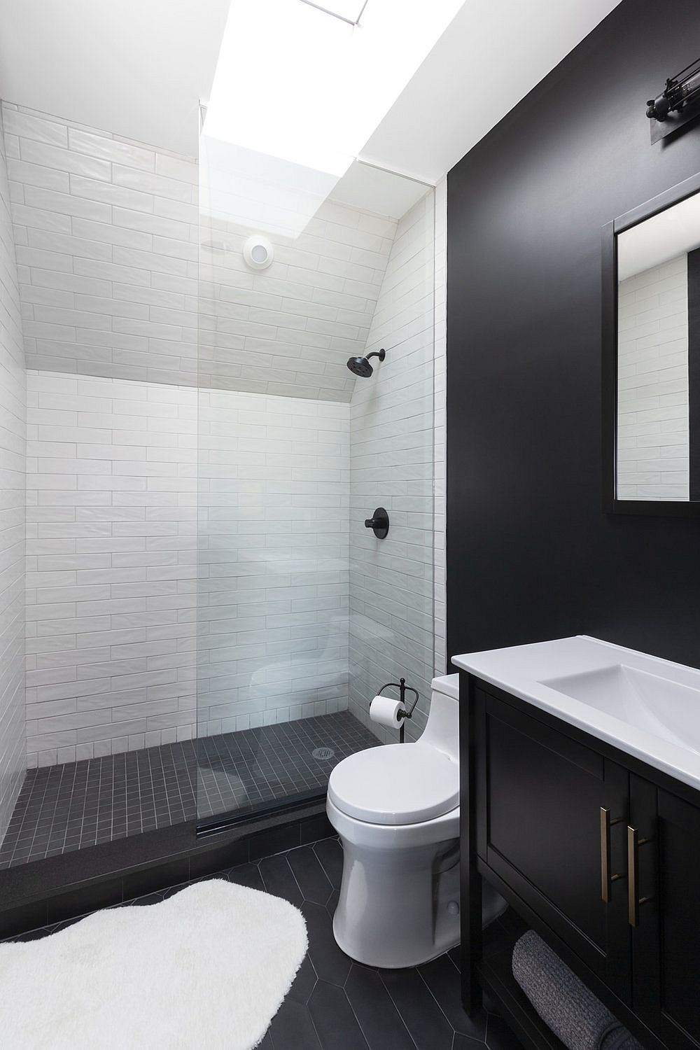 White-shower-area-with-a-skylight-gives-the-bathroom-a-brighter-more-spacious-appeal-35087