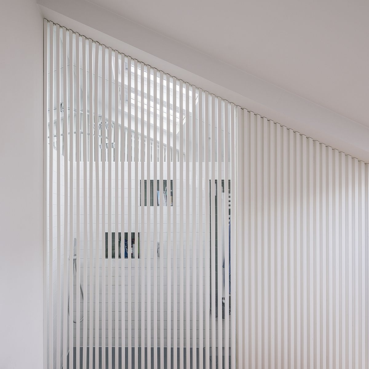 White slats bring light into the shower area
