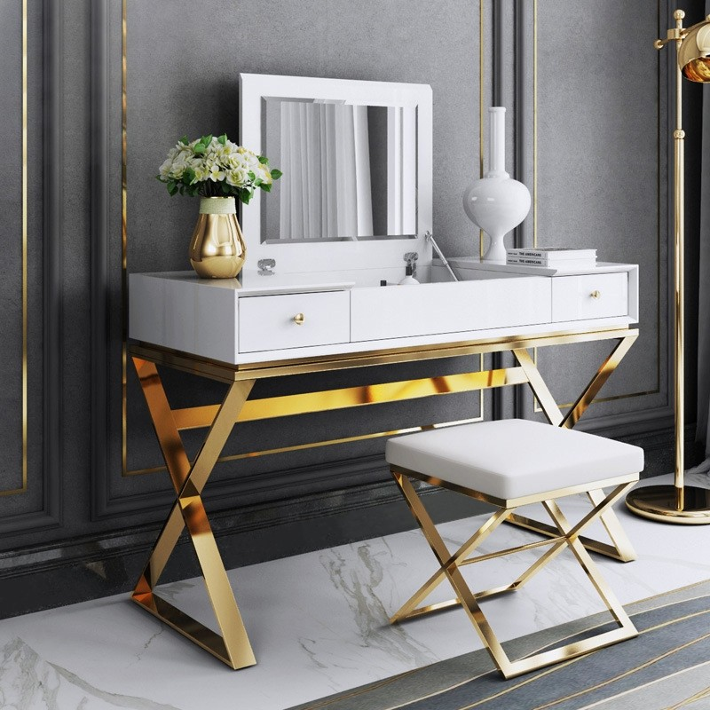 White vanity with gold-toned detailing